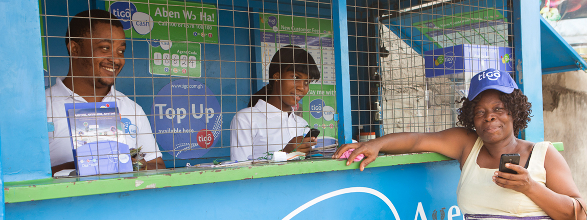 Woman interacts with customer-centric Tigo Cash agents