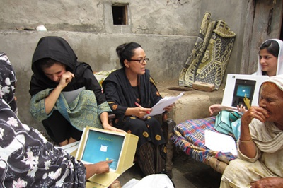 Low-income women customers in Pakistan look at prototype computer screens designed for better, more intuitive, and value-oriented customer experience.
