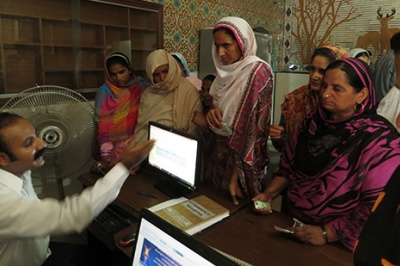 Low-income women experience poor customer service at a bank branch in Pakistan.