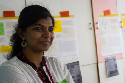 Woman employee at Janalakshmi, India, works on customer empowerment for low-income customer segments